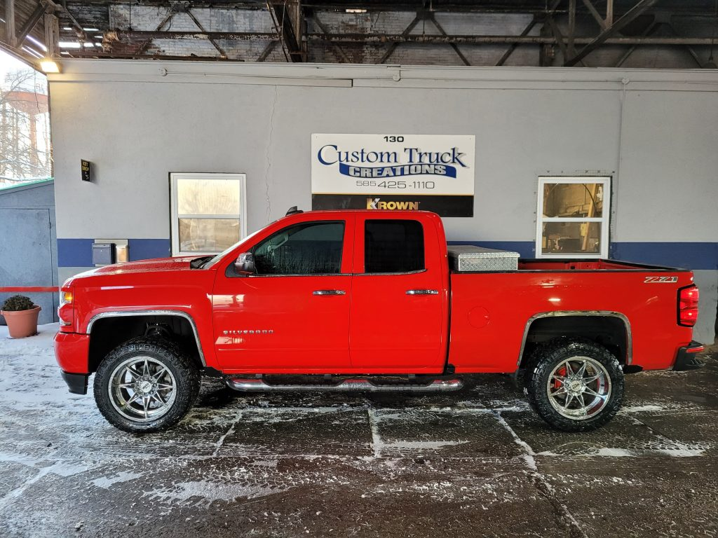 Chevy Silverado with a 3.5 inch Rough Country lift, chrome handles and mirrors