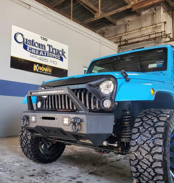 2018 Jeep Wrangler with a Rough Country upper light bar, lower fog lights, and front bumper