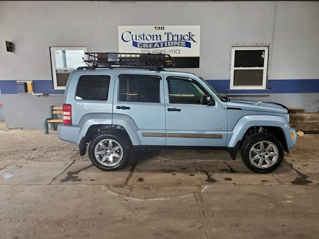 2014 Jeep Liberty with new stock front bumpers, 2.5-inch front & 2 inch rear Rough Country Lift
