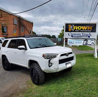 2015 Toyota 4 Runner with a roof rack and light bar